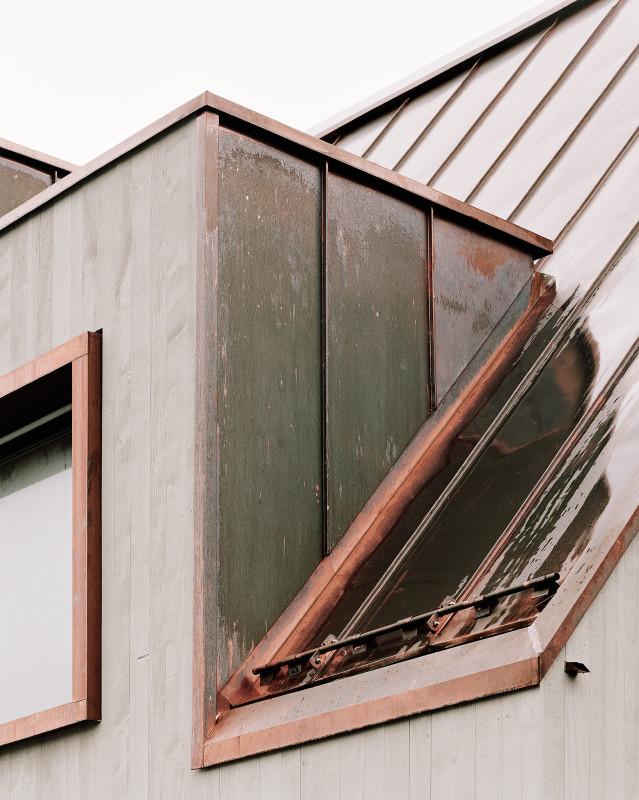 a copper clad community centre by menzi b rgler. Black Bedroom Furniture Sets. Home Design Ideas